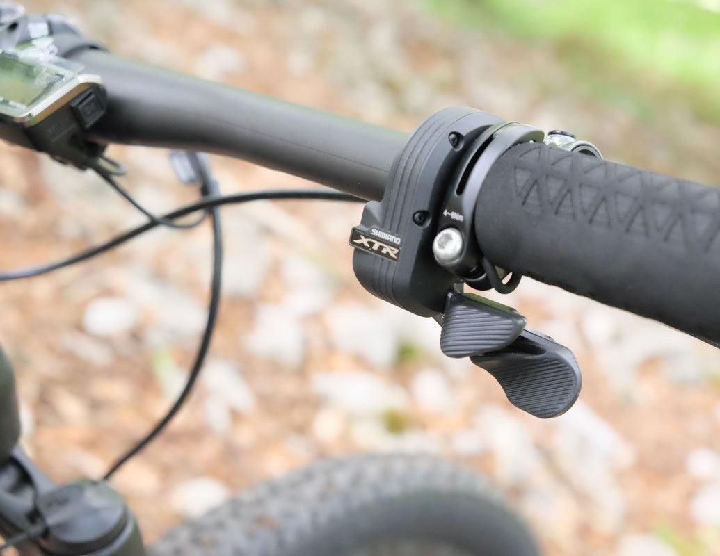 Brilliant: One shifter for both rear and front derailleur and you can do the settings at home from an app.